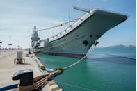 "<p>China has two aircraft carriers on deck. The first, the <em><a href=""https://www.popularmechanics.com/military/navy-ships/a30392809/liaoning-before-and-after/"" rel=""nofollow noopener"" target=""_blank"" data-ylk=""slk:Liaoning"" class=""link rapid-noclick-resp"">Liaoning</a></em>, entered service in 2012. In 1998, a Chinese business man purchased the carrier from the Ukrainian government and announced he was going the ship into a floating casino. Instead, he promptly sold the vessel to the People's Liberation Army Navy (PLAN). Finally, after significant renovation, the <em>Liaoning</em> commissioned. (So far, the vessel has struggled in <a href=""https://www.popularmechanics.com/military/navy-ships/a14017901/china-aircraft-carriers-jellyfish-swarms/"" rel=""nofollow noopener"" target=""_blank"" data-ylk=""slk:the fight against marauding jellyfish"" class=""link rapid-noclick-resp"">the fight against marauding jellyfish</a>.)</p><p>In 2017, PLAN unveiled its first <a href=""https://www.popularmechanics.com/military/navy-ships/a28691324/chinese-aircraft-carrier/"" rel=""nofollow noopener"" target=""_blank"" data-ylk=""slk:domestically built"" class=""link rapid-noclick-resp"">domestically built</a> aircraft carrier, the <em>Shandong</em>. After nearly two years of sea trials, the vessel entered active service. It's been <a href=""https://www.globaltimes.cn/content/1207778.shtml"" rel=""nofollow noopener"" target=""_blank"" data-ylk=""slk:a busy year"" class=""link rapid-noclick-resp"">a busy year</a> for the <em>Shandong</em>, which boasts almost 50,000 tons of displacement and is powered by a conventional propulsion system. Both the <em>Liaoning</em> and the <em>Shandong</em> have a key special feature: a ski-jump takeoff ramp designed to help fighter jets safely launch.</p><p>A third carrier, completely different in design from the PLAN's first two carriers, is currently under development. A <a href=""https://www.theweek.in/news/world/2020/07/18/china-ramps-up-construction-of-3rd-th-aircraft-carriers-report.html"" rel=""nofollow noopener"" target=""_blank"" data-ylk=""slk:rumored fourth carrier"" class=""link rapid-noclick-resp"">rumored fourth carrier</a>, this time powered by nuclear propulsion, may also be in the works. Both of these carriers are <a href=""https://www.theweek.in/news/world/2020/07/18/china-ramps-up-construction-of-3rd-th-aircraft-carriers-report.html"" rel=""nofollow noopener"" target=""_blank"" data-ylk=""slk:reportedly"" class=""link rapid-noclick-resp"">reportedly</a> much larger than China's first two and will be equipped with an electromagnetic catapult designed to fling fighter jets into the air. (None of these vessels, it seems, <a href=""https://www.popularmechanics.com/military/navy-ships/a27228318/flying-chinese-aircraft-carrier/"" rel=""nofollow noopener"" target=""_blank"" data-ylk=""slk:will be able to fly"" class=""link rapid-noclick-resp"">will be able to fly</a>.)</p>"