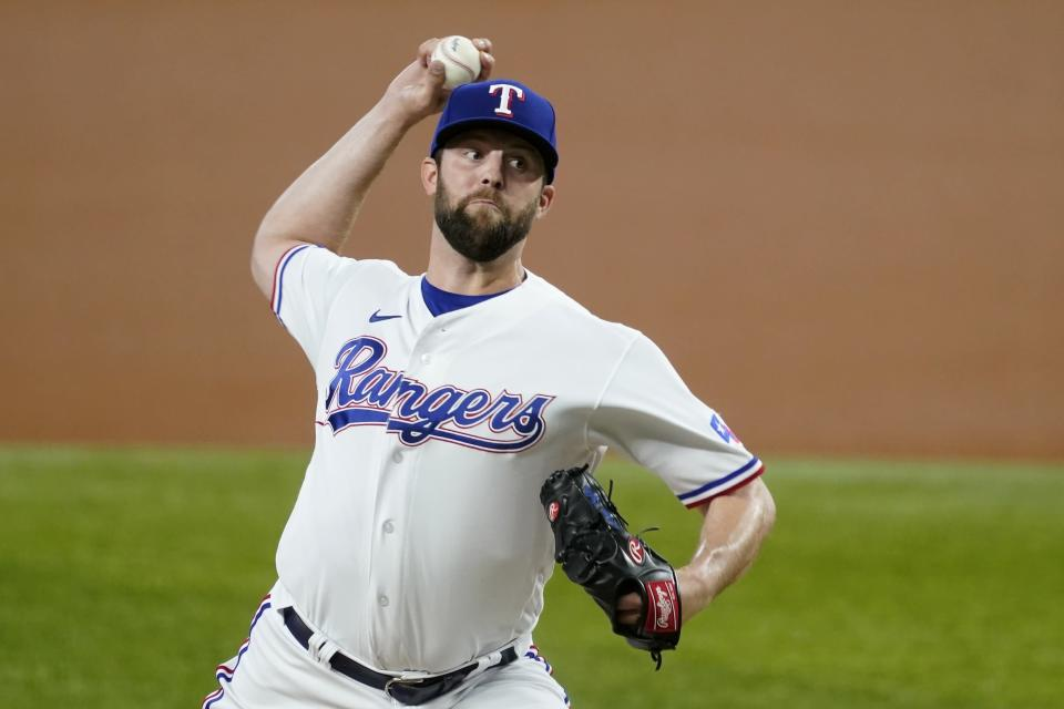 Texas Rangers starting pitcher Jordan Lyles throws to the New York Yankees in the first inning of a baseball game in Arlington, Texas, Monday, May 17, 2021. (AP Photo/Tony Gutierrez)
