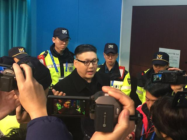 "The Kim Jong Un impersonator from the Opening Ceremony, who says his name is ""Howard"", showed up again at the Korea-Japan women's hockey game. (Photo via Eric Adelson)"