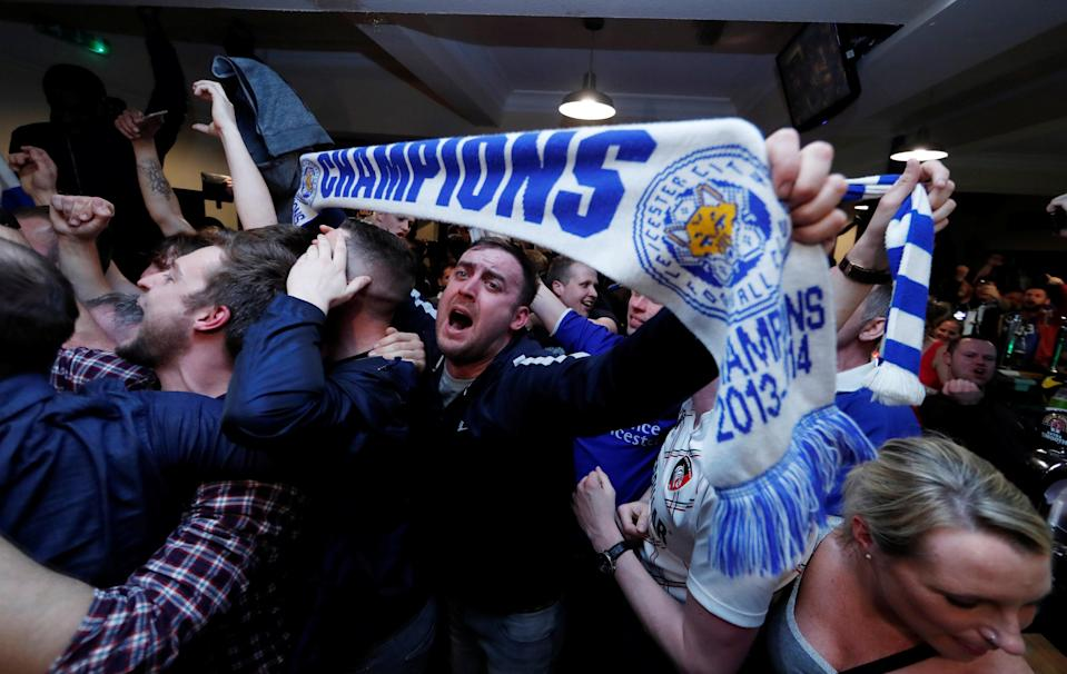 Britain Football Soccer - Leicester City fans watch the Chelsea v Tottenham Hotspur game in pub in Leicester - 2/5/16. Leicester City fans celebrate winning the Premier LeagueReuters / Eddie Keogh Livepic TPX IMAGES OF THE DAY