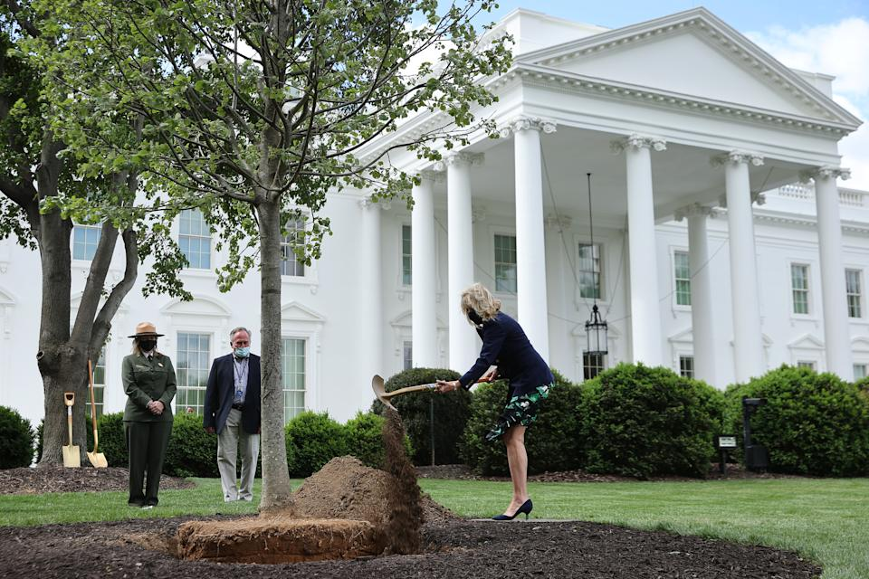 WASHINGTON, DC - APRIL 30: First lady Dr. Jill Biden participates in a tree planting ceremony on the North Lawn of the White House on April 30, 2021 in Washington, DC. In observation of Arbor Day, Biden put three shovels full of dirt around the base of a newly planted Linden tree that replaced one that was removed last month because it was accessed a risk due to decay. (Photo by Chip Somodevilla/Getty Images)