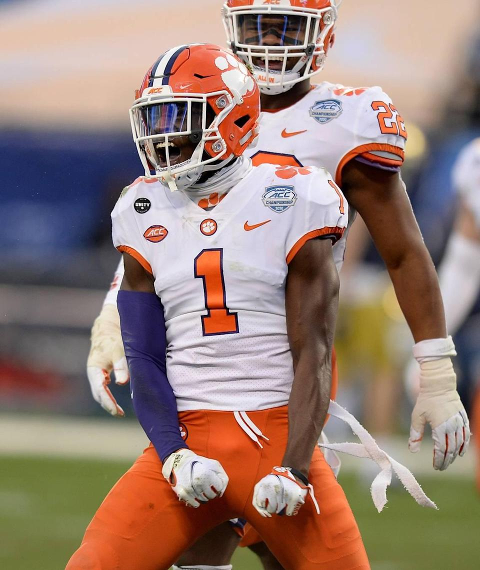 Clemson Tigers cornerback Deion Kendrick celebrates his sack of Notre Dame quarterback Ian Book during second quarter action at Bank of America Stadium on Saturday, December 19, 2020 in Charlotte, NC. The Clemson Tigers and Notre Dame Fighting Irish faced off in the ACC Championship game.