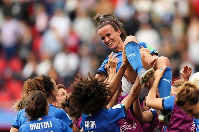 Italy players celebrate victory as they lift Barbara Bonansea of Italy in the air after the 2019 FIFA Women's World Cup France group C match between Australia and Italy at Stade du Hainaut on June 9, 2019 in Valenciennes, France. (Photo by Molly Darlington - AMA/Getty Images)