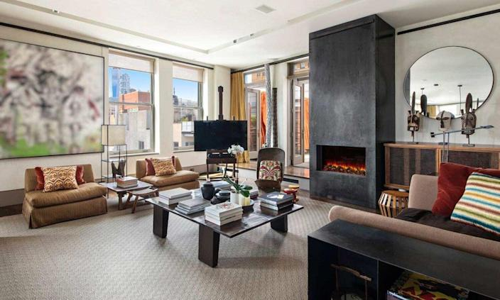 Cozy, stylish fireplace area inside David Bowie's recently-sold Manhattan apartment.