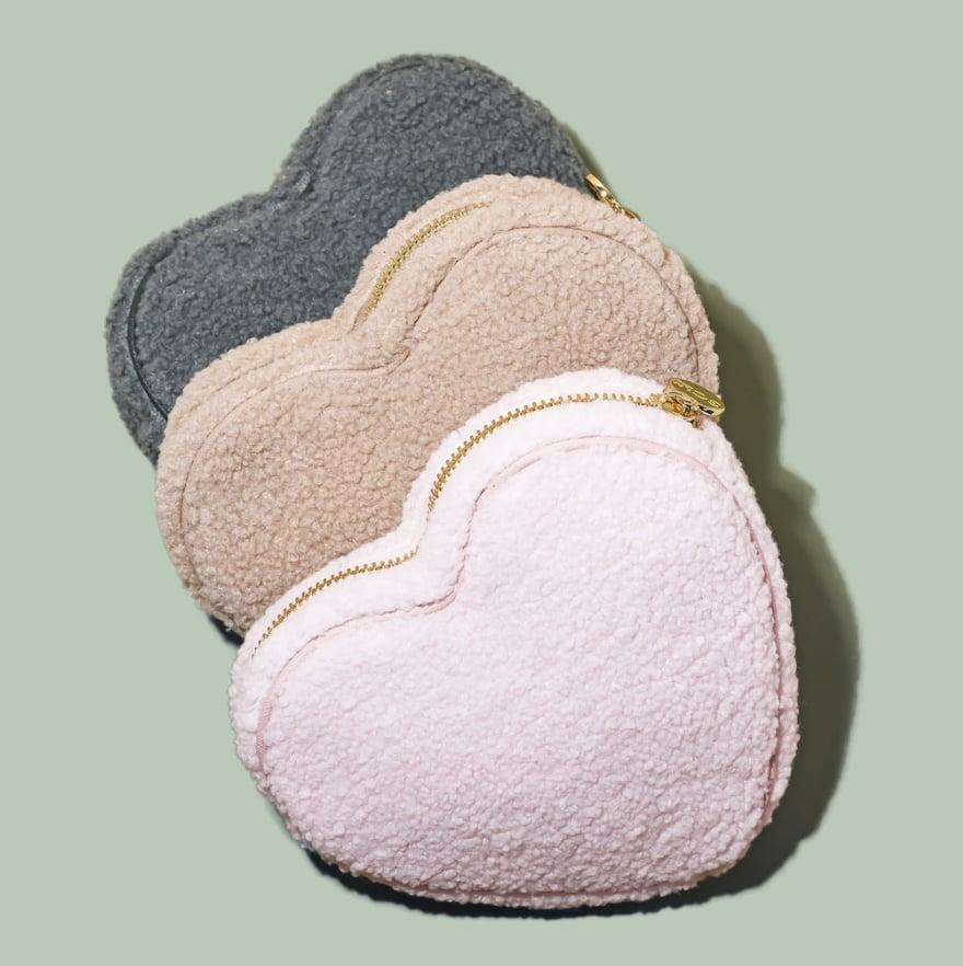 <p>The fabric of these <span>Stoney Clover Lane Cozy Heart Pouches</span> ($98 each) looks so soft.</p>