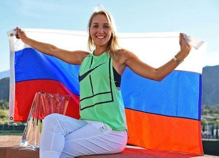 Mar 19, 2017; Indian Wells, CA, USA; Elena Vesnina (RUS) poses with the championship trophy and Russian flag after winning the women's final in the BNP Paribas Open at the Indian Wells Tennis Garden. Mandatory Credit: Jayne Kamin-Oncea-USA TODAY Sports