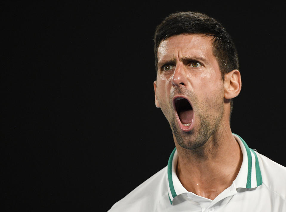 Serbia's Novak Djokovic celebrates after winning the second set against Russia's Aslan Karatsev during their semifinal match at the Australian Open tennis championship in Melbourne, Australia, Thursday, Feb. 18, 2021.(AP Photo/Andy Brownbill)