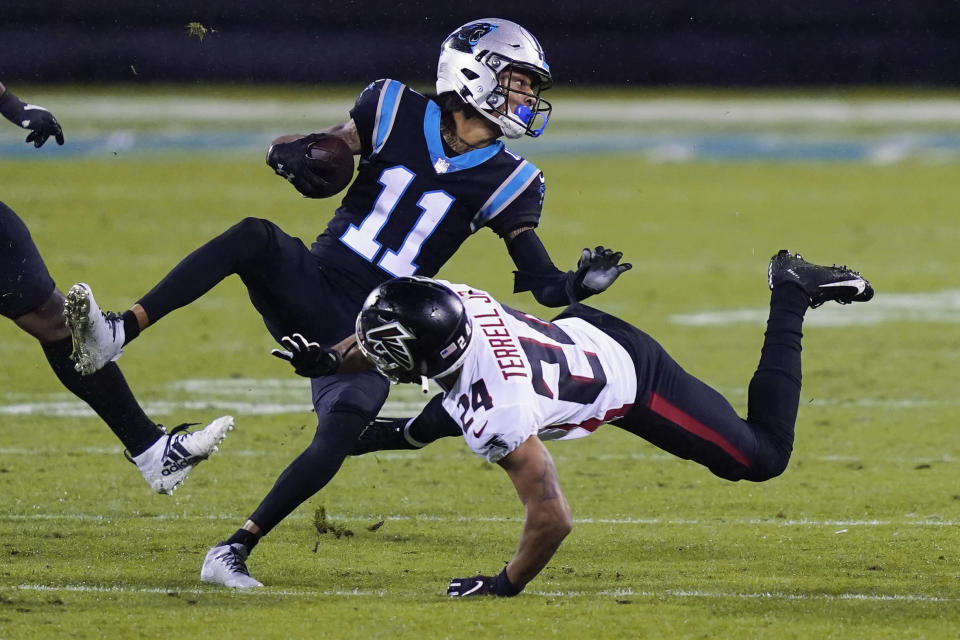 Carolina Panthers wide receiver Robby Anderson is tackled by Atlanta Falcons cornerback A.J. Terrell during the second of an NFL football game Thursday, Oct. 29, 2020, in Charlotte, N.C. (AP Photo/Gerry Broome)
