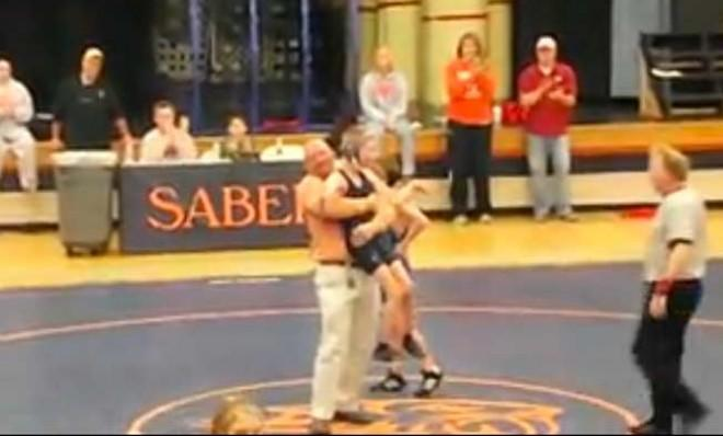 Jared Stevens is hoisted up after winning, in a matter of speaking, his first high school wrestling match.