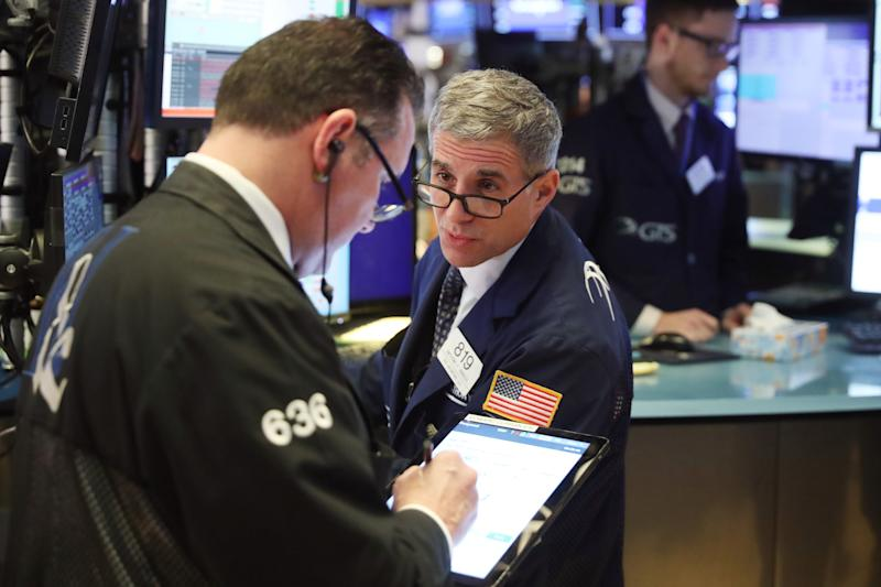 Traders work on the floor of the New York Stock Exchange shortly after the opening bell in New York, U.S., February 6, 2020. REUTERS/Lucas Jackson