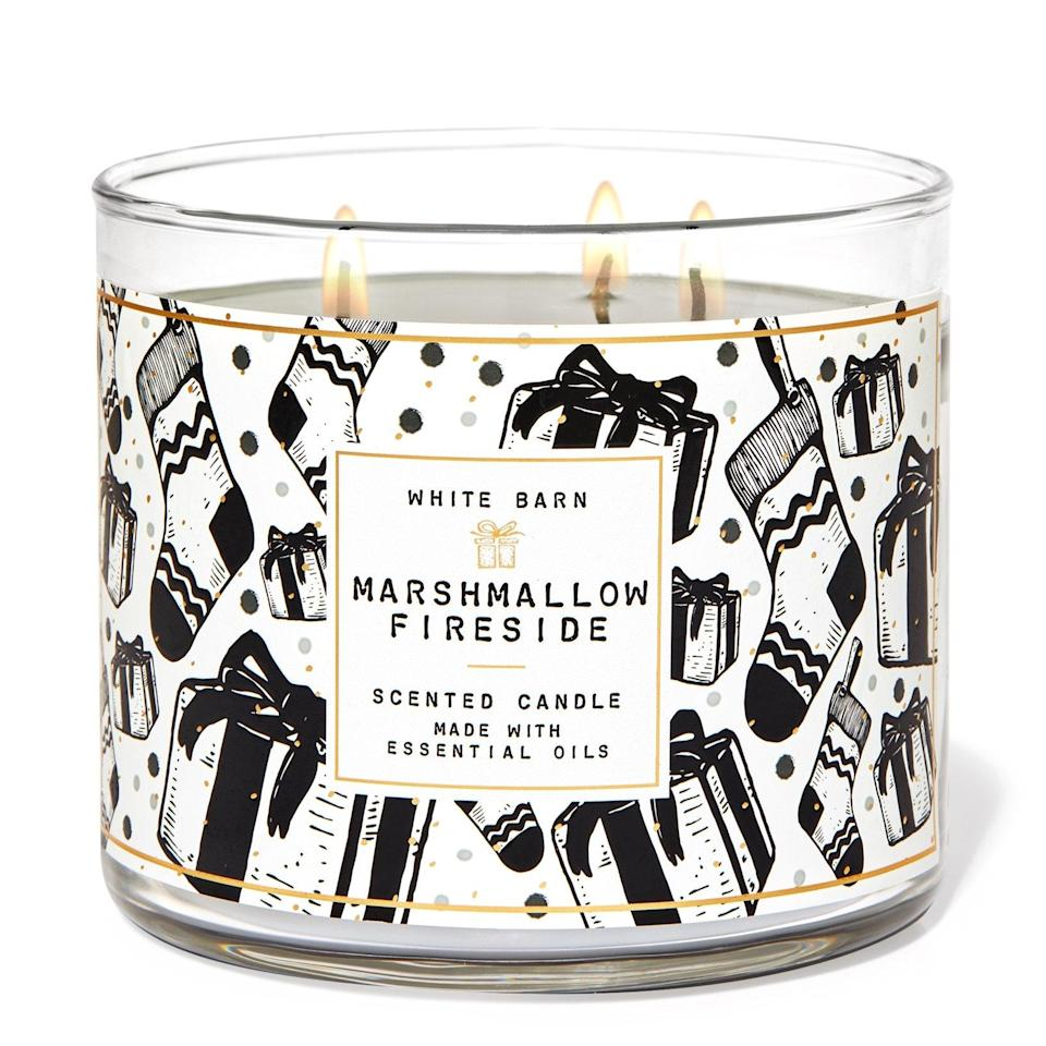 "<p>If you can't roast marshmallows indoors, this candle from Bath & Body Works is the next best thing. The brand's fan-favorite Fireside Three-Wick Candle is inexpensive and smells delightful. Toasted marshmallow, fire-roasted vanilla, smoldering woods and crystalized amber come together for a warm, sweet fragrance that reminds you of the holidays without being too heavy-handed on the season's more traditional scents.</p> <p><strong>Was $25, now $15</strong> (<a href=""https://www.bathandbodyworks.com/p/marshmallow-fireside-3-wick-candle-026182154.html"" rel=""nofollow noopener"" target=""_blank"" data-ylk=""slk:Shop Now"" class=""link rapid-noclick-resp"">Shop Now</a>)</p>"