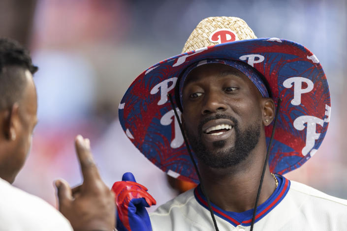 Philadelphia Phillies ' Andrew McCutchen celebrates after hitting a home run during the fifth inning of a baseball game against the Miami Marlins, Sunday, July 18, 2021, in Philadelphia. (AP Photo/Laurence Kesterson)