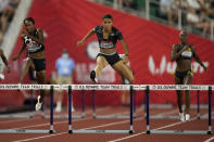 Sydney McLaughlin sets a new world record in the finals of the women's 400-meter hurdles at the U.S. Olympic Track and Field Trials Sunday, June 27, 2021, in Eugene, Ore.(AP Photo/Ashley Landis)