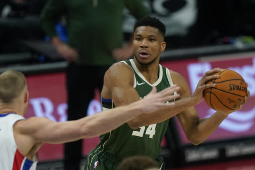 Milwaukee Bucks forward Giannis Antetokounmpo (34) looks to pass during the first half of an NBA basketball game against the Detroit Pistons, Wednesday, Jan. 13, 2021, in Detroit. (AP Photo/Carlos Osorio)