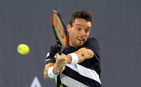 FILE PHOTO: Tennis - Mubadala World Tennis Championship - Men's Finals - Abu Dhabi, UAE - December 30, 2017. Roberto Bautista Agut of Spain in action against Kevin Anderson of South Africa. REUTERS/Satish Kumar