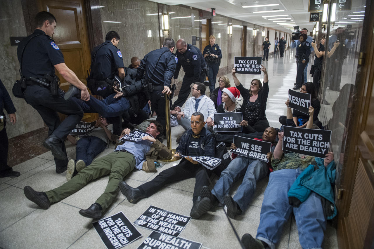 <p>Protesters disrupt the Senate Budget Committee markup of the tax reform bill in Dirksen Building on Nov. 28, 2017. (Photo: Tom Williams/CQ Roll Call/Getty Images) </p>
