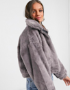 "Category is: Cozy enough to sleep in. $56, ASOS. <a href=""https://www.asos.com/us/asos-petite/asos-design-petite-cropped-faux-fur-jacket-in-gray/prd/14895083"" rel=""nofollow noopener"" target=""_blank"" data-ylk=""slk:Get it now!"" class=""link rapid-noclick-resp"">Get it now!</a>"