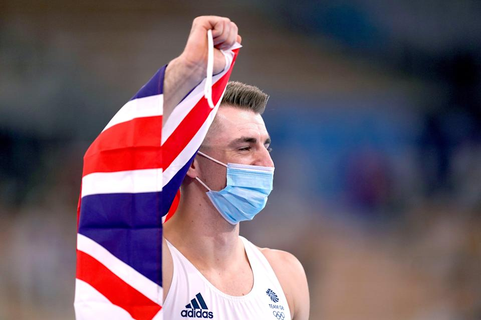 Great Britain's Max Whitlock celebrates after winning the gold medal in the men's pommel horse (Mike Egerton/PA) (PA Wire)