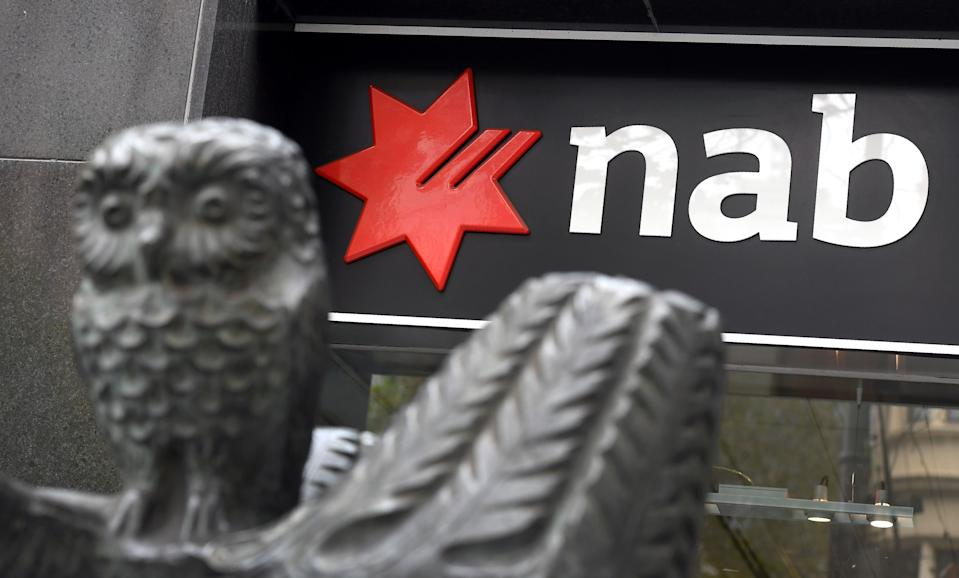 """A National Australia Bank (NAB) sign adorns a branch of the bank in Melbourne on May 2, 2019, as the NAB revealed that in the last six months it had put aside 368 million US dollars for """"customer-related remediation costs,"""" bringing the total provisions to 770 million. - Australia's big banks -- once among the most profitable in the world -- are being forced to amass war chests worth billions of dollars to reimburse customers for years of dodgy fees. (Photo by William WEST / AFP) (Photo by WILLIAM WEST/AFP via Getty Images)"""