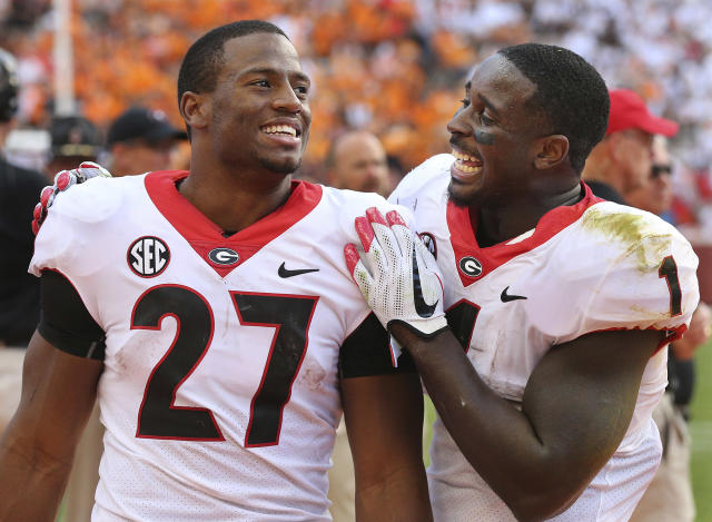 If not for the decisions by tailbacks Nick Chubb (L) and Sony Michel to return for their senior seasons, Georgia almost assuredly wouldn't have made the College Football Playoff. (AP)