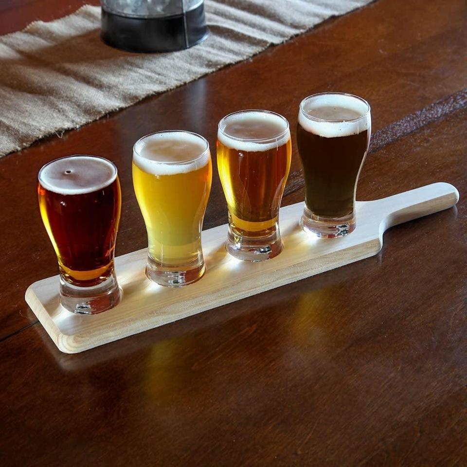 <p>You'll be the life of the party with this <span>Beer Flight Paddle and Sample Tasting Set</span> ($25).</p>