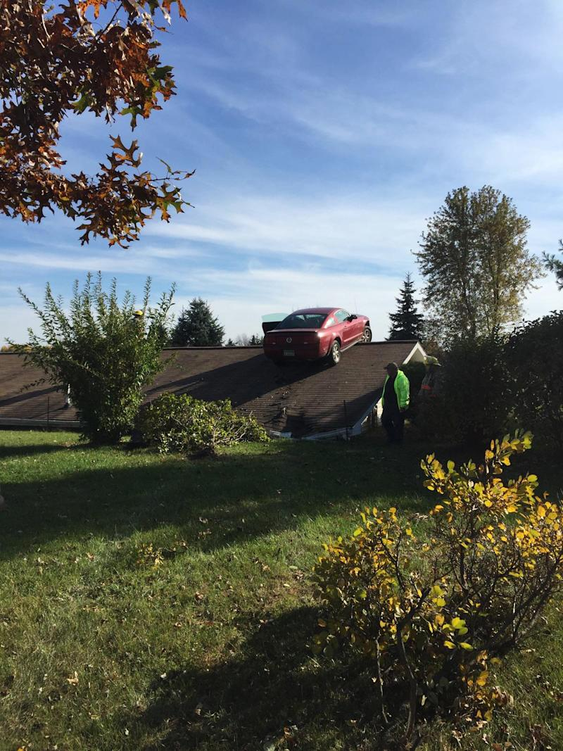Owner Hears 'Kaboom,' Finds a Ford Mustang on Roof of Her Home