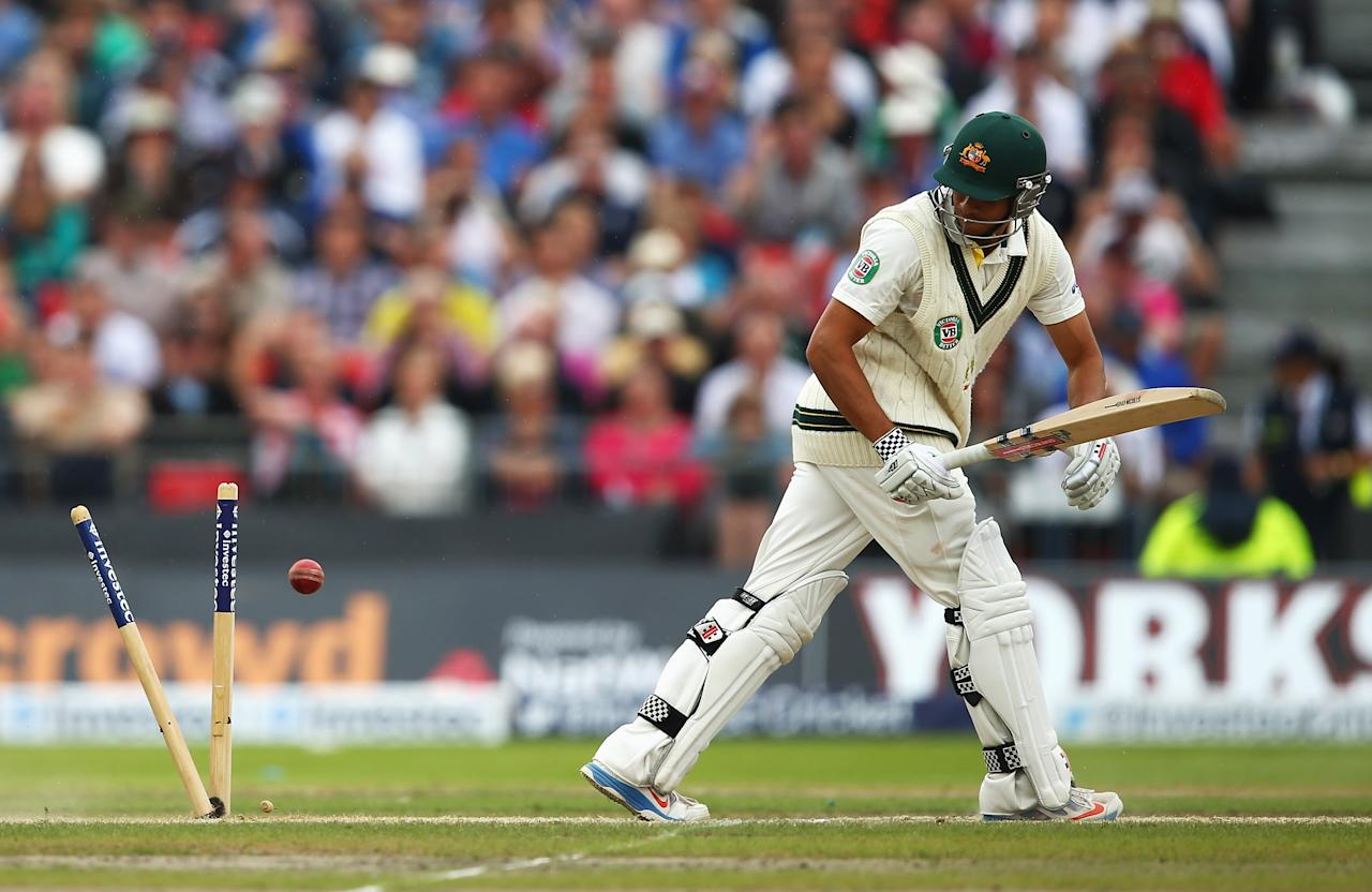 MANCHESTER, ENGLAND - AUGUST 04: Usman Khawaja of Australia is bowled by Graeme Swann of England during day four of the 3rd Investec Ashes Test match between England and Australia at Emirates Old Trafford Cricket Ground on August 4, 2013 in Manchester, England. (Photo by Michael Steele/Getty Images)
