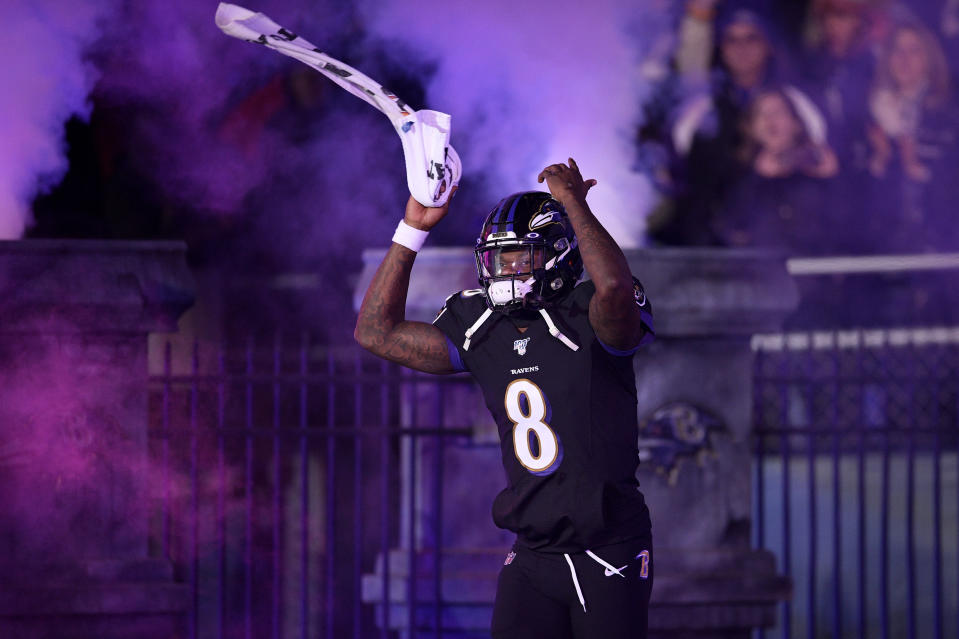 Baltimore Ravens quarterback Lamar Jackson is introduced onto the field prior to an NFL football game against the New York Jets, Thursday, Dec. 12, 2019, in Baltimore. (AP Photo/Nick Wass)