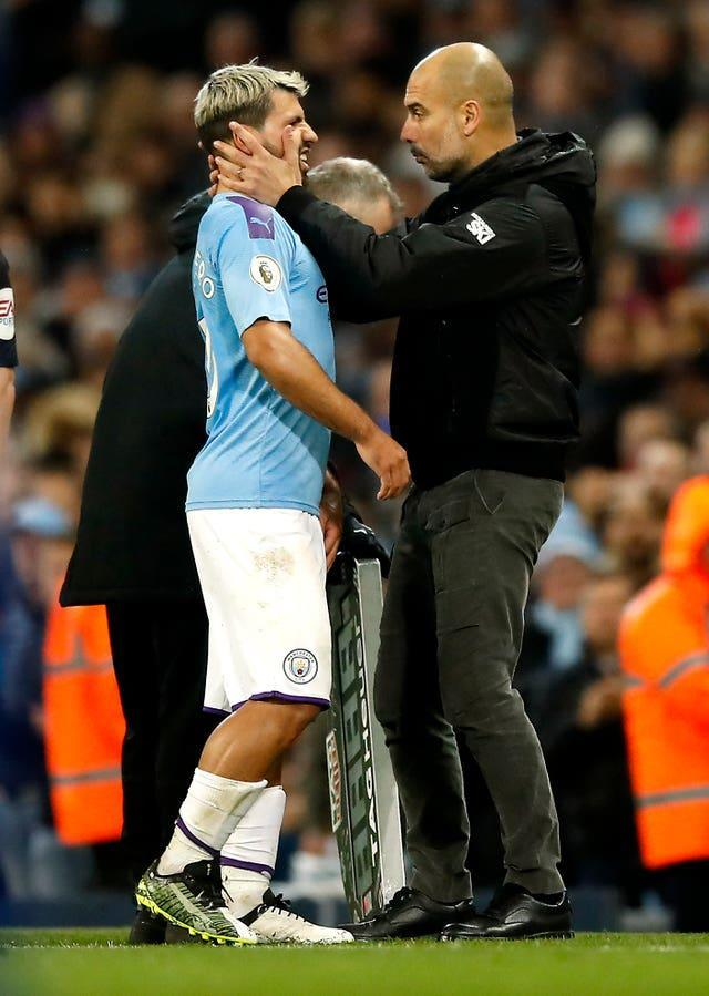 Guardiola (right) still expects to see goals from Aguero this season