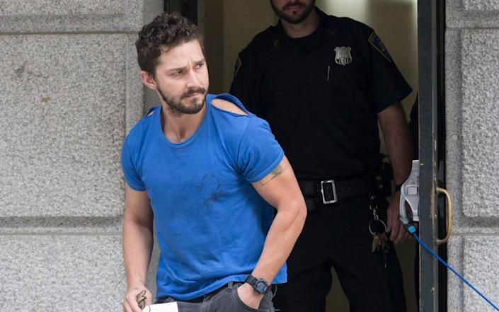 """Actor Shia LaBeouf leaves Midtown Community Court after being arrested the previous day for yelling obscenities at the Broadway show """"Cabaret"""" in New York in 2014 - AP"""