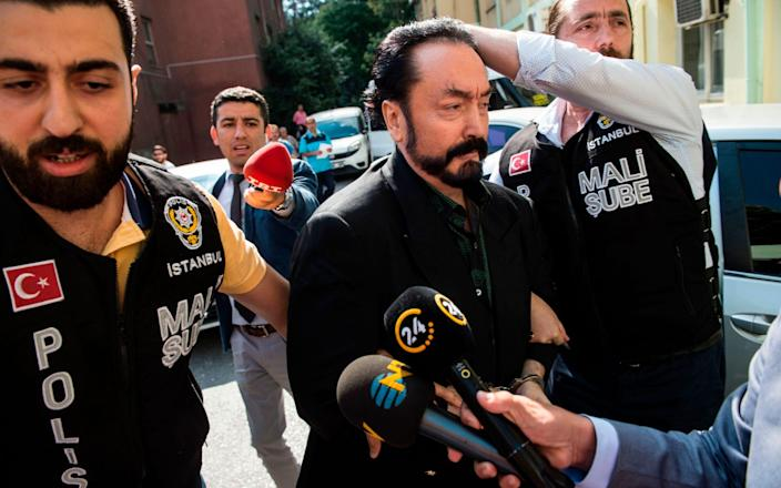 """A Turkish court has sentenced a Muslim televangelist who surrounded himself with scantily clad women he called """"kittens"""" to more than 1,000 years in jail for sex crimes - AFP/AFP"""