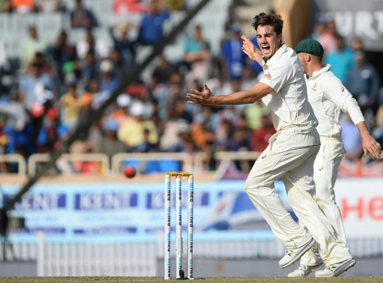 Australian bowler Pat Cummins celebrates after he dismissed Indian batsman Ravichandran Ashwin during the third day of the third Test in Ranchi, on March 18, 2017