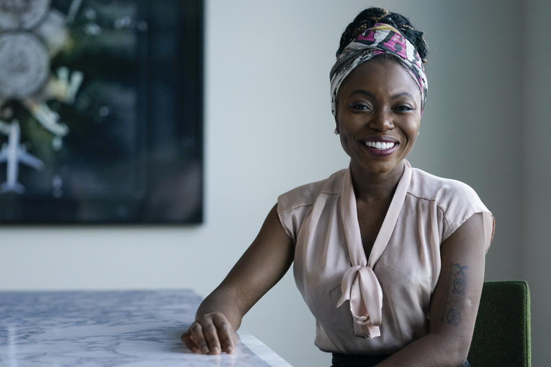 """In this Wednesday, June 10, 2020, photo, Sharon Chuter poses for a portrait in Los Angeles. After hitting the streets to protest racial injustices last week, Chuter was disillusioned by the number of corporate brands posting """"glossy"""" messages spouting support for black lives. The 33-year-old founder of Uoma Beauty, a cosmetics company that caters to black women, launched the #pulluporshutup campaign on Instagram to push brands to reveal the racial makeup of their corporate workforce and executives, and the hashtag has since gone viral. (AP Photo/Ashley Landis)"""