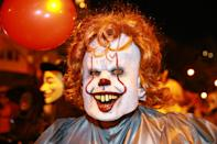 """<p>A man dressed up as the killer clown Pennywise from the movie """"It""""€ participates in the 44th annual Village Halloween Parade in New York City on Oct. 31, 2017. (Photo: Gordon Donovan/Yahoo News) </p>"""