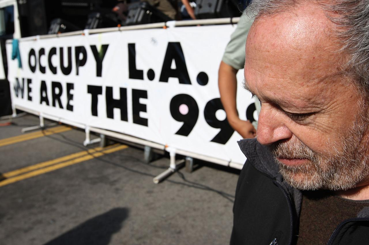 LOS ANGELES, CA - NOVEMBER 5:  Former U.S. Secretary of Labor Robert Reich awaits his introduction to speak to Occupy Los Angeles protesters after the Move Your Money March through the downtown financial district during what is being called Bank Transfer Day, on November 5, 2011 in Los Angeles, California. Occupy movement members are calling for people to move their money from banks to credit unions today in support of the 99% movement.   (Photo by David McNew/Getty Images)