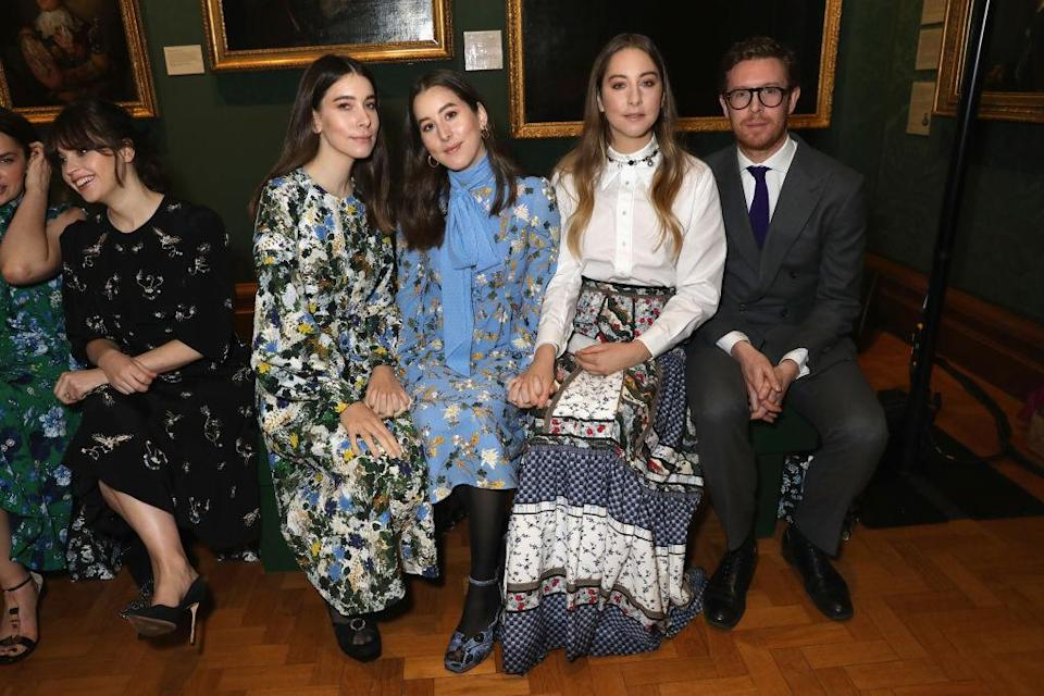 <p>The Haim sisters sat FROW at the Erdem show in dainty dresses by the beloved label. <em>[Photo: Getty]</em> </p>