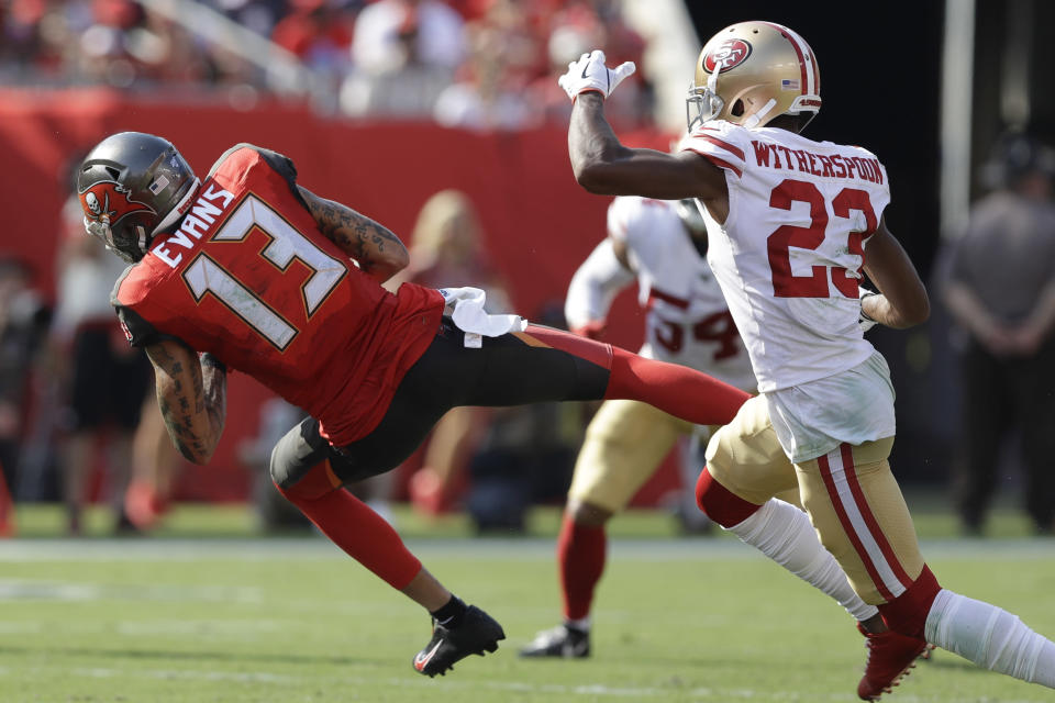 Tampa Bay Buccaneers wide receiver Mike Evans (13) makes the catch ahead of San Francisco 49ers cornerback Ahkello Witherspoon (23) during the first half an NFL football game, Sunday, Sept. 8, 2019, in Tampa, Fla. (AP Photo/Chris O'Meara)