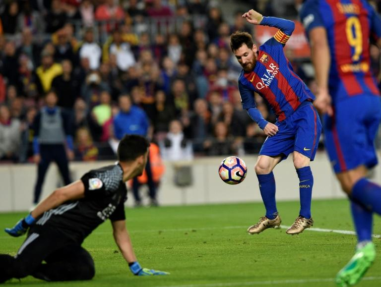 Barcelona's Lionel Messi scores a goal during a match against Real Sociedad in Barcelona on April 15, 2017
