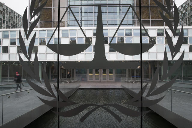 A person leaves the International Criminal Court in The Hague, Netherlands, Wednesday, Jan. 16, 2019, where lawyers were scheduled to discuss the next steps in the case of Gbagbo and ex-youth minister Charles Ble Goude, a day after both men were acquitted of crimes against humanity. (AP Photo/Peter Dejong)