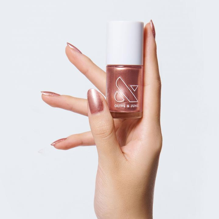 """<h3>Olive & June OJSM</h3><br>Olive & June's beautiful, trend-setting polishes are proof that a great gift doesn't need to break the bank. """"With their innate champagne wishes and caviar dreams, your Libra bestie will totally appreciate this pink gold nail polish as a birthday gift,"""" says Stardust.<br><br><strong>Olive & June</strong> OJSM, $, available at <a href=""""https://go.skimresources.com/?id=30283X879131&url=https%3A%2F%2Ffave.co%2F3631brZ"""" rel=""""nofollow noopener"""" target=""""_blank"""" data-ylk=""""slk:Olive & June"""" class=""""link rapid-noclick-resp"""">Olive & June</a>"""