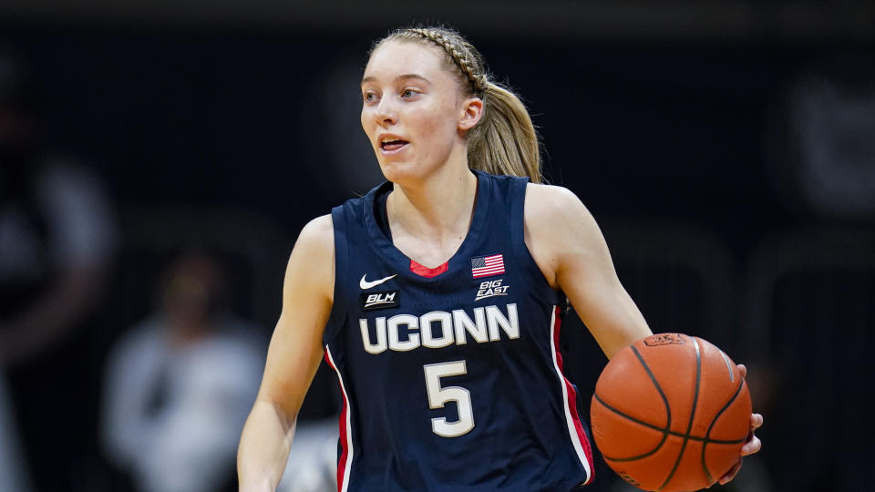 Connecticut guard Paige Bueckers (5) plays against Butler during the first quarter of an NCAA college basketball game in Indianapolis, Saturday, Feb. 27, 2021. (AP Photo/Michael Conroy)