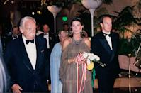 """<p>Princess Caroline (in <a href=""""https://www.townandcountrymag.com/style/jewelry-and-watches/news/a3225/10-things-you-didnt-know-about-cartiers-tutti-frutti-designs/"""" rel=""""nofollow noopener"""" target=""""_blank"""" data-ylk=""""slk:Cartier's Tutti Frutti"""" class=""""link rapid-noclick-resp"""">Cartier's Tutti Frutti</a> necklace) and Prince Albert at the Red Cross Ball in 1994.</p>"""