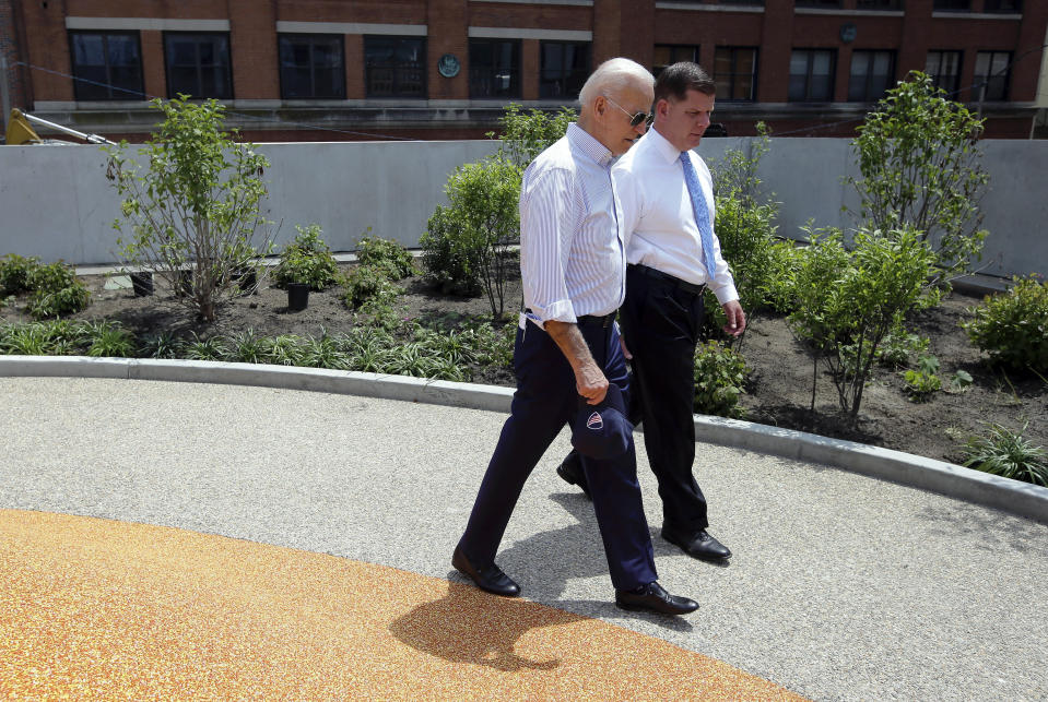 Former vice president and Democratic presidential candidate Joe Biden walks on Wednesday, June 5, 2019, beside Boston Mayor Marty Walsh, right, in a park in being constructed in Boston in honor of Martin Richard, the youngest victim of the 2013 Boston Marathon bombings. (AP Photo/Steven Senne)