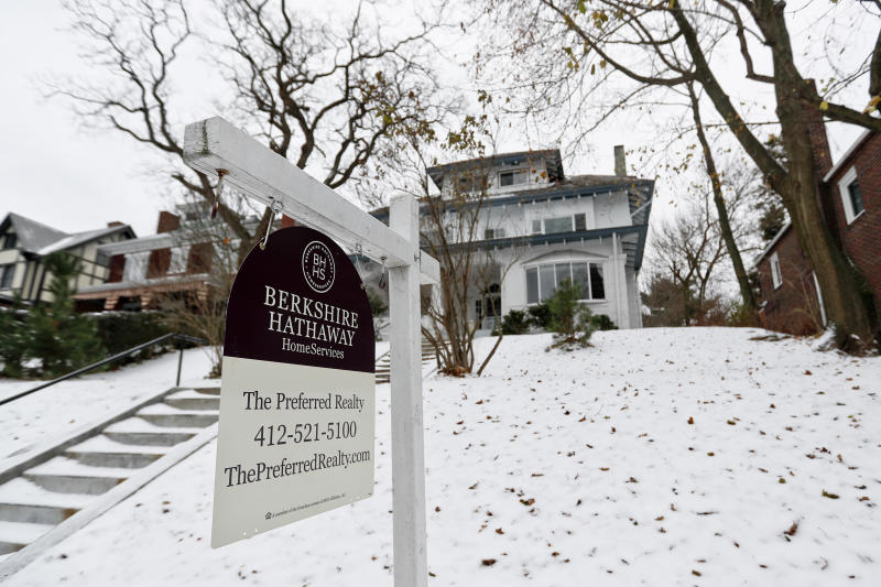 In this Wednesday, Nov. 28, 2018, photo, a realtor sign hangs in front of a home for sale in Pittsburgh. On Thursday, Nov. 29, Freddie Mac reports on the week's average U.S. mortgage rates. (AP Photo/Keith Srakocic)