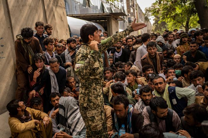 September 12, 2021: Afghans wait in front of a bank as they try to withdraw money in Kabul, Afghanistan.