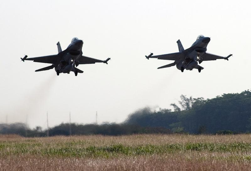 Two US-made F-16 fighter jets take off from the Chiayi air force base in southern Taiwan during a demonstration