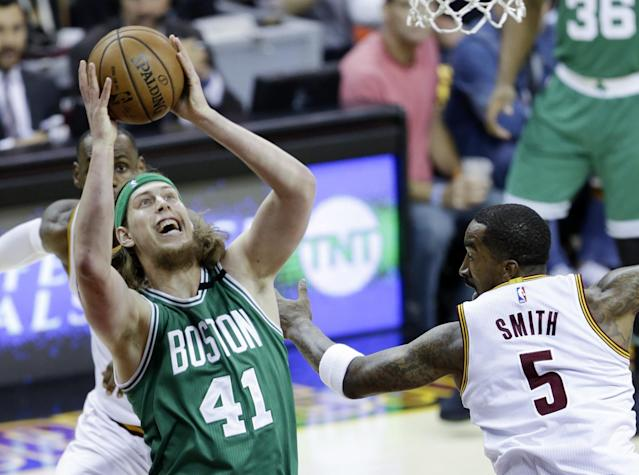 <p>Boston Celtics' Kelly Olynyk (41) grabs a rebound against Cleveland Cavaliers' J.R. Smith (5) during the first half of Game 4 of the NBA basketball Eastern Conference finals, Tuesday, May 23, 2017, in Cleveland. (AP Photo/Tony Dejak) </p>