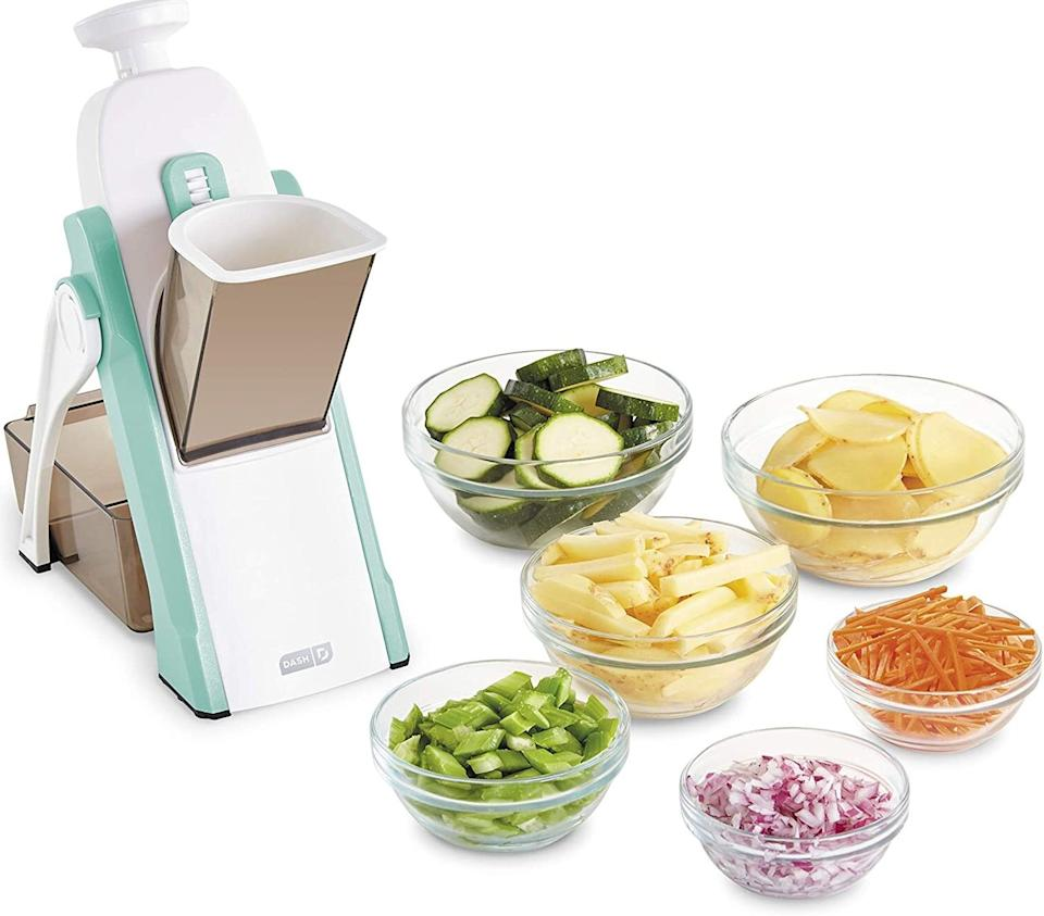 """Youcan use this to create one of those Pinterest-worthy vegetable platters shaped like a flower or a rainbow — so fun!<br /><br /><strong>Promising review:</strong>""""This item is amazing for both its safety features and ease of use.<strong>I am a bit of a kitchen klutz and feel completely at ease and fearless with this device.</strong>I made my own potato chips — I sliced with my Dash mandolin and cooked in my<a href=""""https://www.amazon.com/dp/B07GNSHPBQ?tag=huffpost-bfsyndication-20&ascsubtag=5817703%2C28%2C43%2Cd%2C0%2C0%2C0%2C962%3A1%3B901%3A2%3B900%3A2%3B974%3A3%3B975%3A2%3B982%3A2%2C16180719%2C0"""" target=""""_blank"""" rel=""""nofollow noopener noreferrer"""" data-skimlinks-tracking=""""5817703"""" data-vars-affiliate=""""Amazon"""" data-vars-asin=""""B07GNSHPBQ"""" data-vars-href=""""https://www.amazon.com/dp/B07GNSHPBQ?tag=bfheather-20&ascsubtag=5817703%2C28%2C43%2Cmobile_web%2C0%2C0%2C16180719"""" data-vars-keywords=""""cleaning"""" data-vars-link-id=""""16180719"""" data-vars-price="""""""" data-vars-product-id=""""17928121"""" data-vars-product-img=""""https://m.media-amazon.com/images/I/414Sw+fIfGL._SL500_.jpg"""" data-vars-product-title=""""Dash DFAF455GBAQ01 Deluxe Electric Air Fryer + Oven Cooker with Temperature Control, Non-stick Fry Basket, Recipe Guide + Auto Shut Off Feature, 1700-Watt, 6 Quart, 6 qt, Aqua"""" data-vars-retailers=""""Amazon"""">Dash air fryer</a>. The tasted just like the ones i get from my favorite Portuguese restaurant but I'm hoping they are much healthier. I honestly think this is a must have for all at home chefs."""" —<a href=""""https://www.amazon.com/dp/B07XZYV3WJ?tag=huffpost-bfsyndication-20&ascsubtag=5817703%2C28%2C43%2Cd%2C0%2C0%2C0%2C962%3A1%3B901%3A2%3B900%3A2%3B974%3A3%3B975%3A2%3B982%3A2%2C16180718%2C0"""" target=""""_blank"""" rel=""""noopener noreferrer"""">Dawn</a><br /><br /><strong>Get it from Amazon for <a href=""""https://www.amazon.com/dp/B07XZYV3WJ?tag=huffpost-bfsyndication-20&ascsubtag=5817703%2C28%2C43%2Cd%2C0%2C0%2C0%2C962%3A1%3B901%3A2%3B900%3A2%3B974%3A3%3B975%3A2%3B982%3A2%2C16180718%2C0"""" target=""""_bla"""