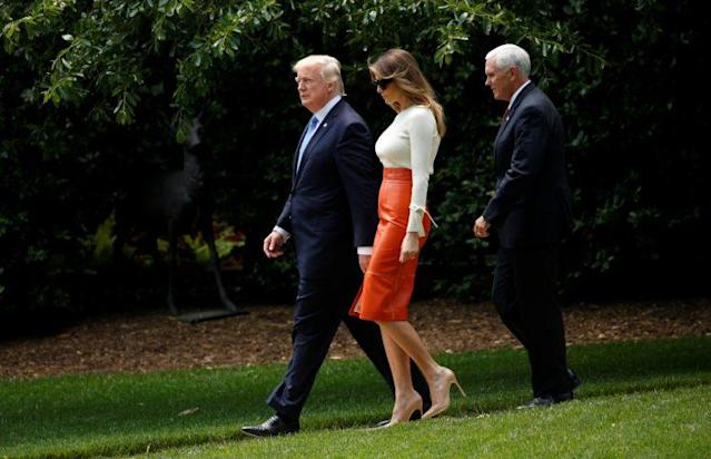 Donald Trump and his wife Melania are escorted by Vice President Mike Pence as the Trumps depart the White House to embark on a trip to the Middle East and Europe, in Washington, U.S., May 19, 2017. (Photo: Reuters/Kevin Lamarque)