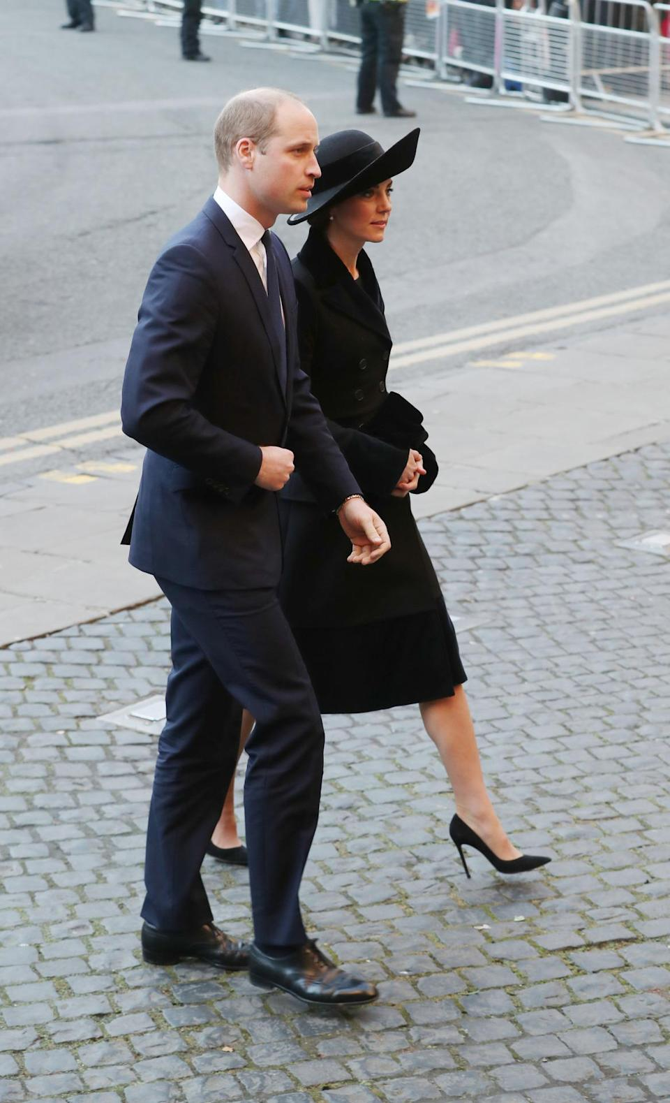 <p>Kate recycled a bespoke black Alexander McQueen coat for the Duke of Westminster's memorial service. She first wore the velvet and wool ensemble in 2015 and on this occasion paired it with a wide-brimmed hat by Sylvia Fletcher. Suede Gianvito Rossi heels completed the look. </p><p><i>[Photo: PA]</i></p>